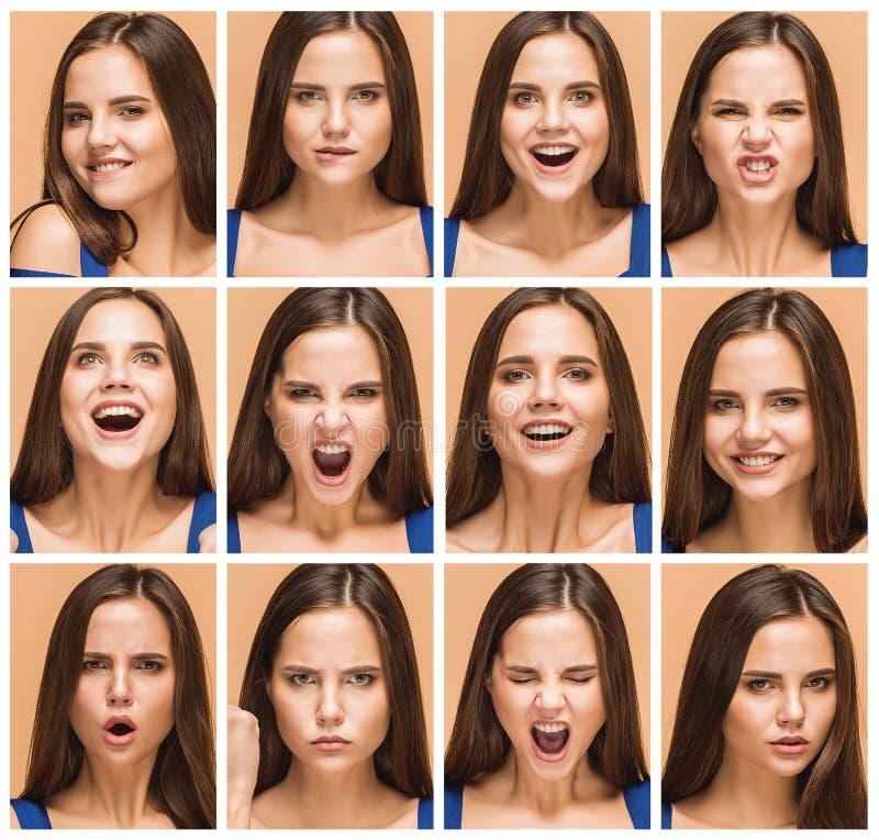 Les émotions de la jeune femme de brune studio image stock
