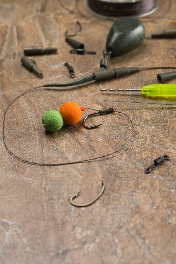 Les amorces, crochets, platines, ledcor se prépare à la pêche de carpe Copiez la pâte image stock