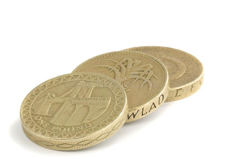 Les Anglais pièces de monnaie d'une livre sur un blanc photos stock