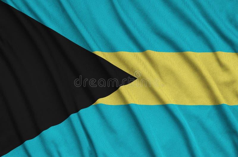 Les Bahamas diminuent sont dépeintes sur un tissu de tissu de sports avec beaucoup de plis Bannière d'équipe de sport illustration libre de droits