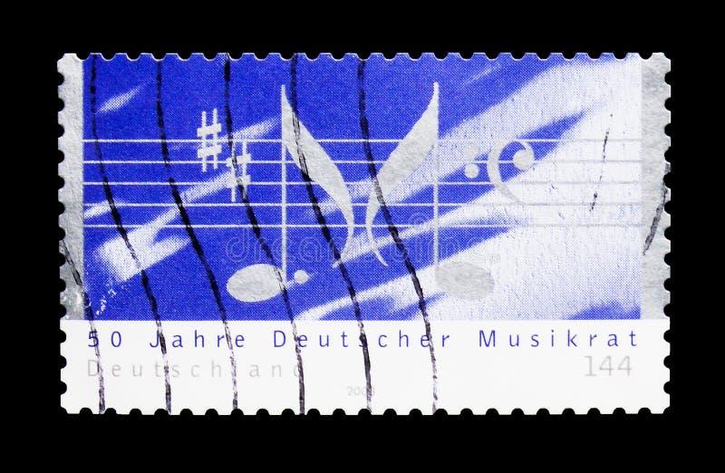 Les barres, notes forment la lettre M, le serie allemand du Conseil de musique, cercle image libre de droits