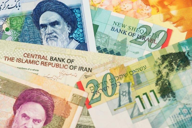 Les billets de banque Israël Shekel et Iran Rial Currency ferment l'image photographie stock