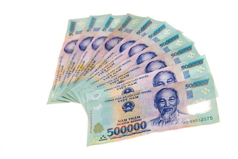 Les billets de banque vietnamiens de coup de devise arrangent dans une rangée photo stock