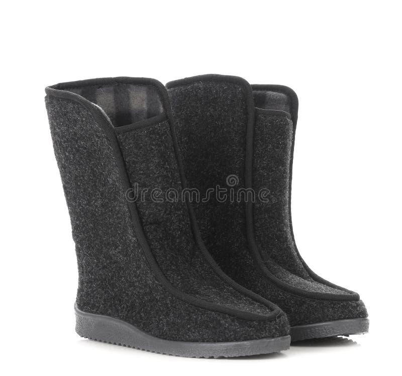 Les bottes de l'homme d'hiver. photo libre de droits