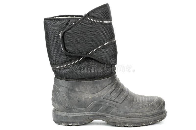 les bottes des vieux hommes en caoutchouc, à l'intérieur isolées avec la fourrure image libre de droits