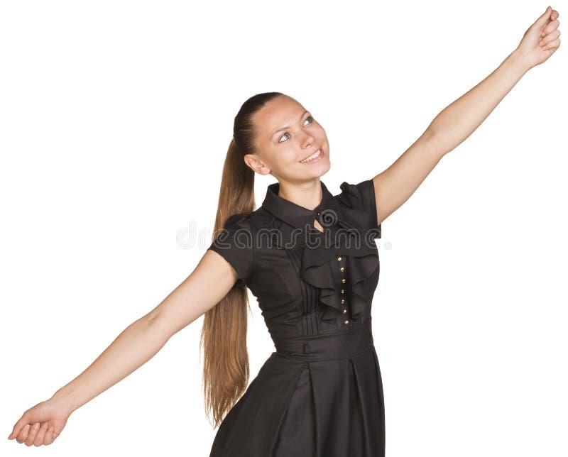 Les bras heureux de jeune femme s'ouvrent photo stock