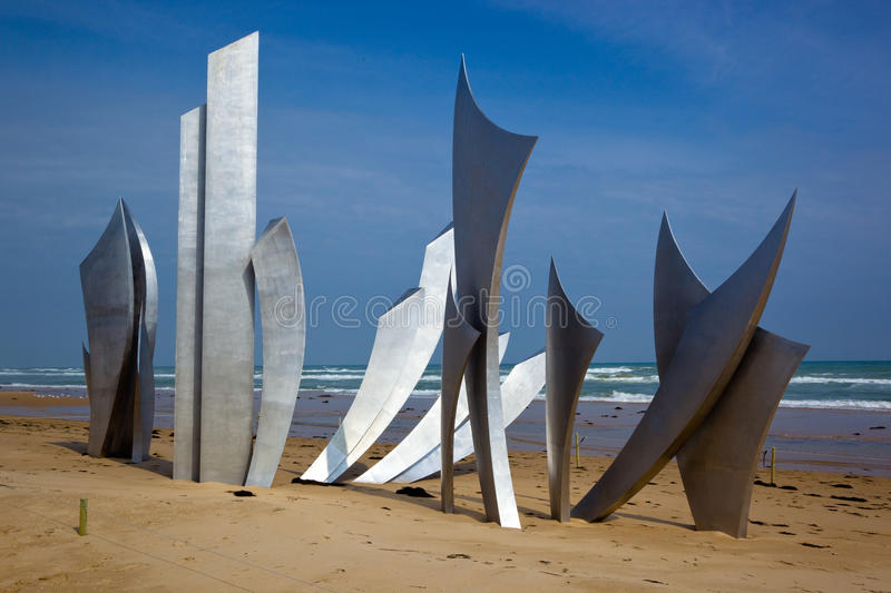 Les Braves at Omaha beach. Les Braves sculpture at Omaha beach, Normandy, France royalty free stock photography