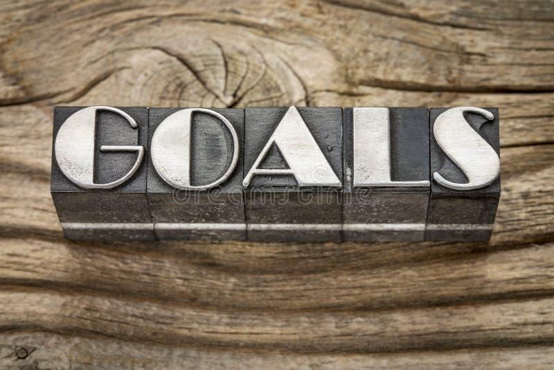 Les buts expriment dans le type en métal photo libre de droits