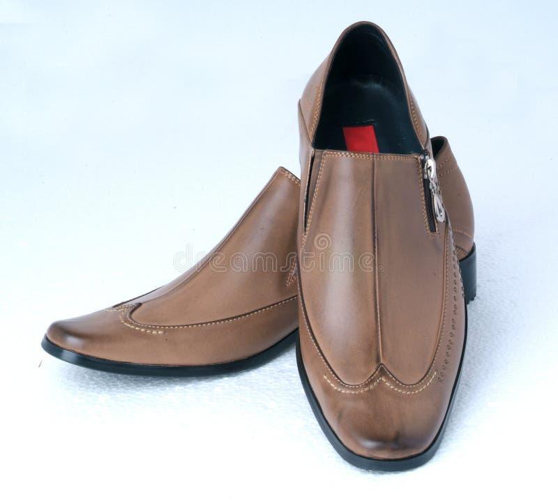 Les chaussures de l'homme image libre de droits