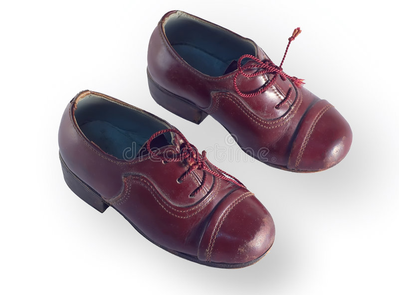 Les chaussures des enfants antiques image stock