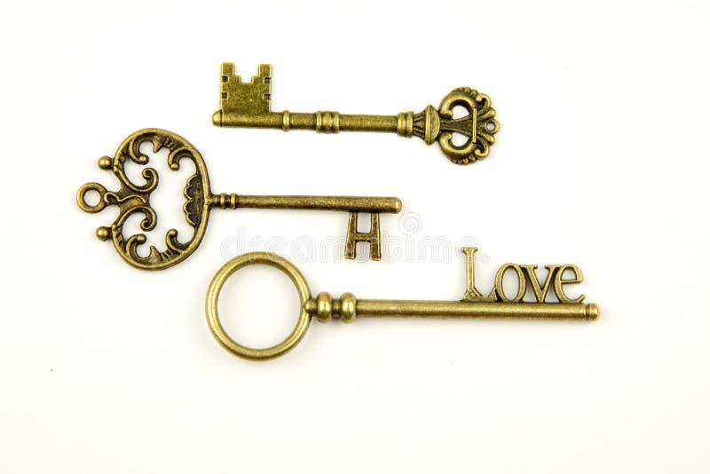 Les clés médiévales ornementales de vintage avec la pièce forgéee complexe, composée d'éléments de fleur de lis, les rouleaux de  images stock