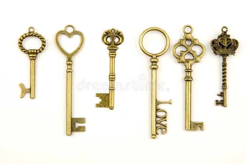 Les clés médiévales ornementales de vintage avec la pièce forgéee complexe, composée d'éléments de fleur de lis, les rouleaux de  image stock