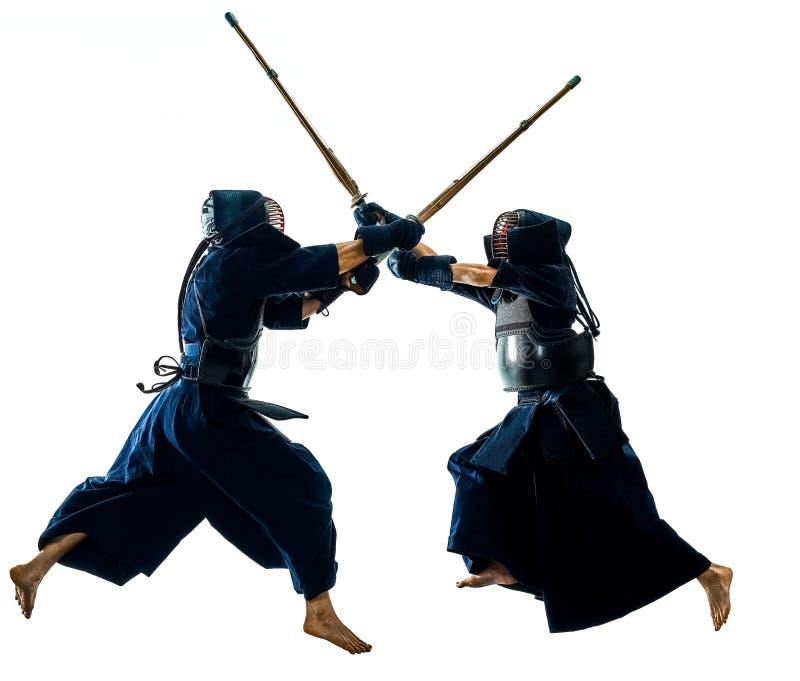 Les combattants d'arts martiaux de Kendo silhouettent le bacground blanc d'isolement images stock