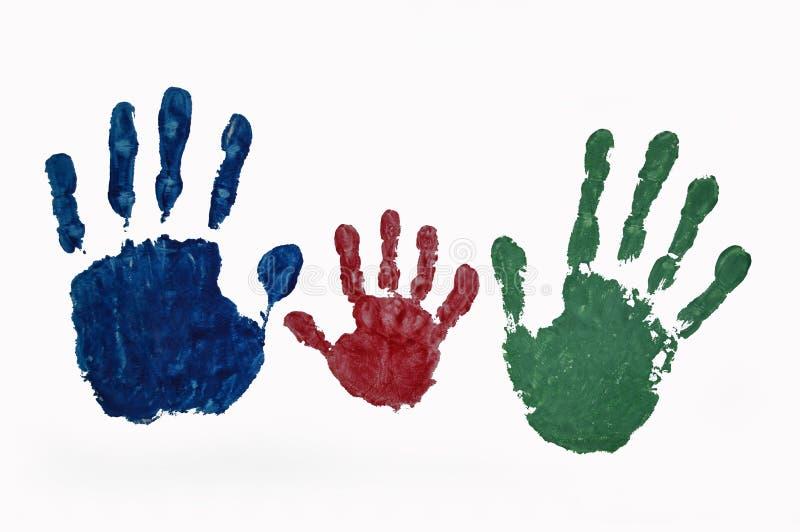 Les copies de main de la famille ont coloré la peinture sur le fond blanc photos stock