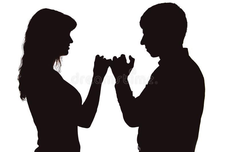 Les couples ont mis de pair comme signe de la réconciliation photographie stock