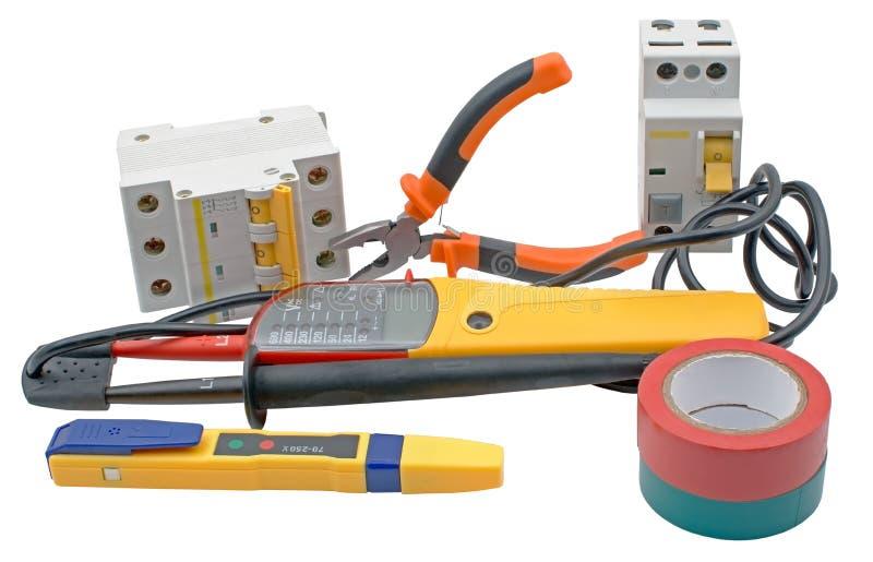 Les disjoncteurs automatiques, bande d'isolation, appareils de contrôle ont isolé dessus photographie stock libre de droits
