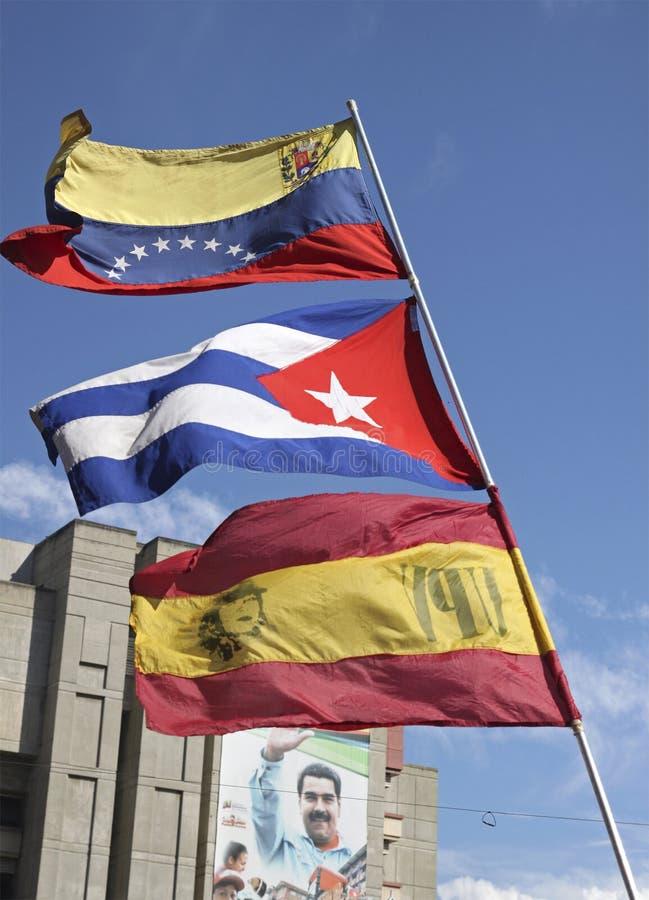 Les drapeaux du Venezuela, du Cuba et de l'unité populaire vénézuélienne font la fête UPV photos stock