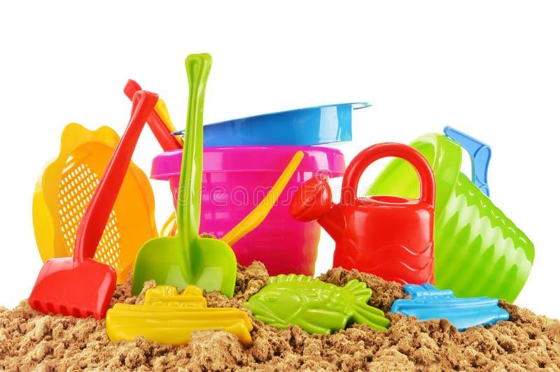 les enfants de plastique joue pour jouer dans le bac sable ou sur une plage photo stock. Black Bedroom Furniture Sets. Home Design Ideas