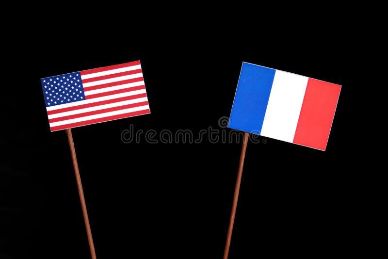Les Etats-Unis diminuent avec le drapeau français sur le noir image stock