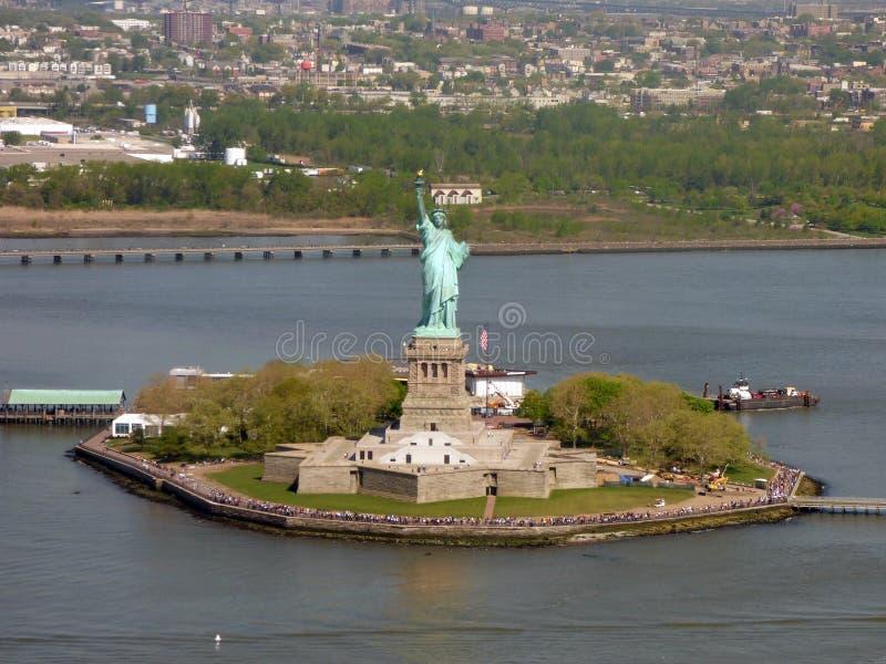 LES Etats-Unis New York Statue de la liberté et du coucher du soleil de New York City photos stock