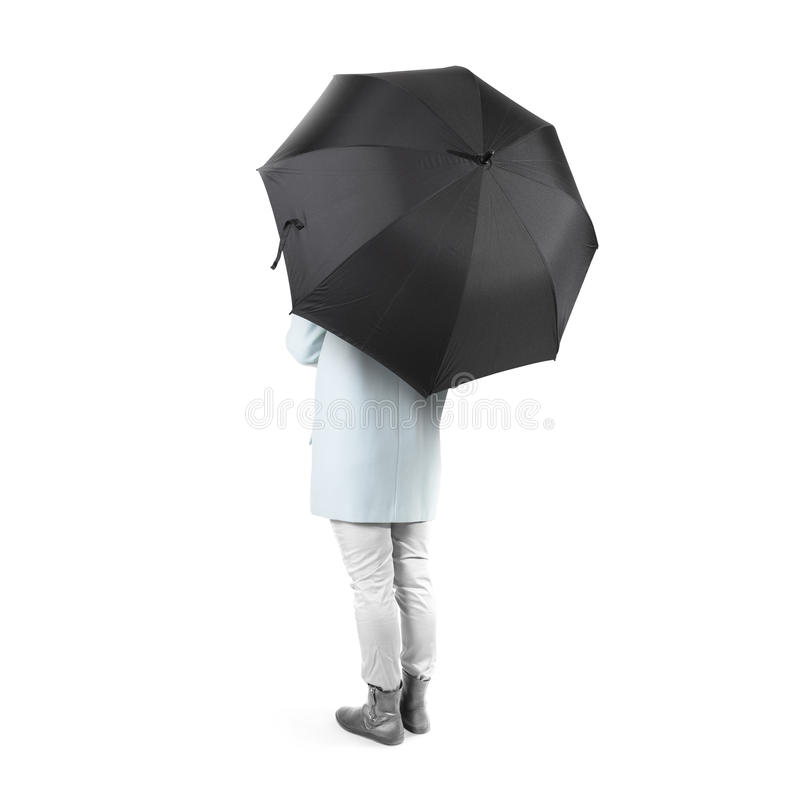 Les femmes se tiennent vers l'arrière avec la moquerie vide noire de parapluie d'isolement photos stock