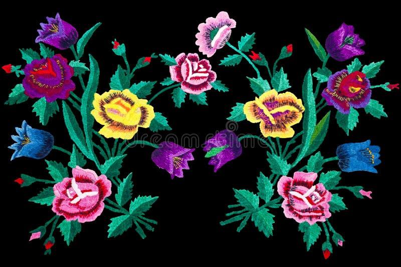 Les fleurs de point de broderie ont isolé le fond noir photos stock