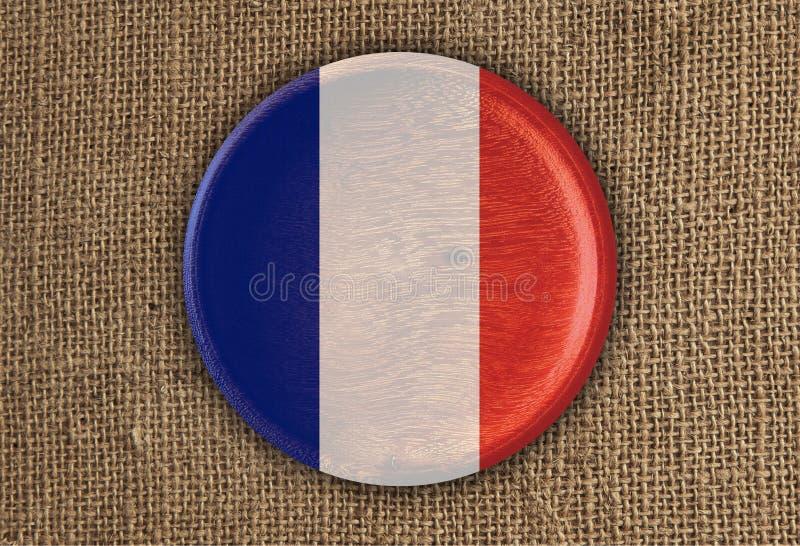 Les Frances ont donné une consistance rugueuse autour du bois de drapeau sur le tissu rugueux photos libres de droits