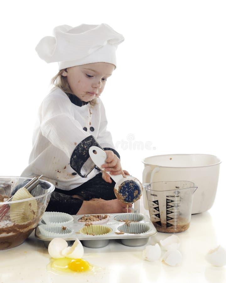 Les gâteaux de petit Baker photographie stock