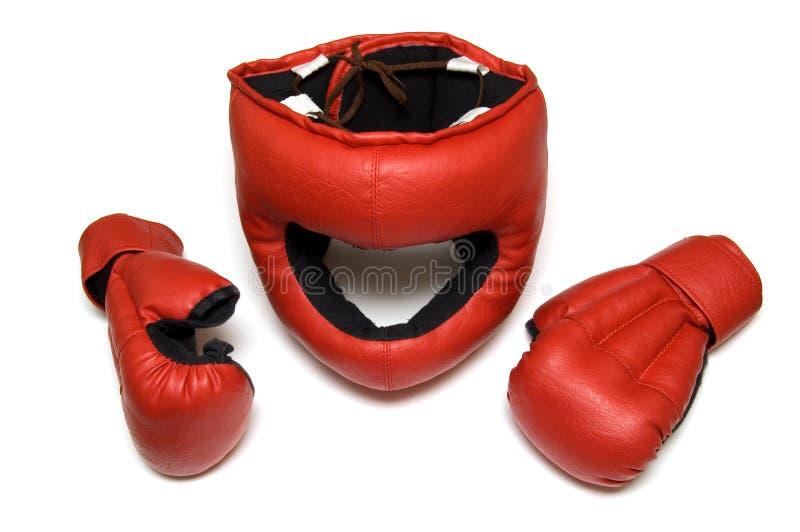 les gants de combat remettent le casque à photos libres de droits