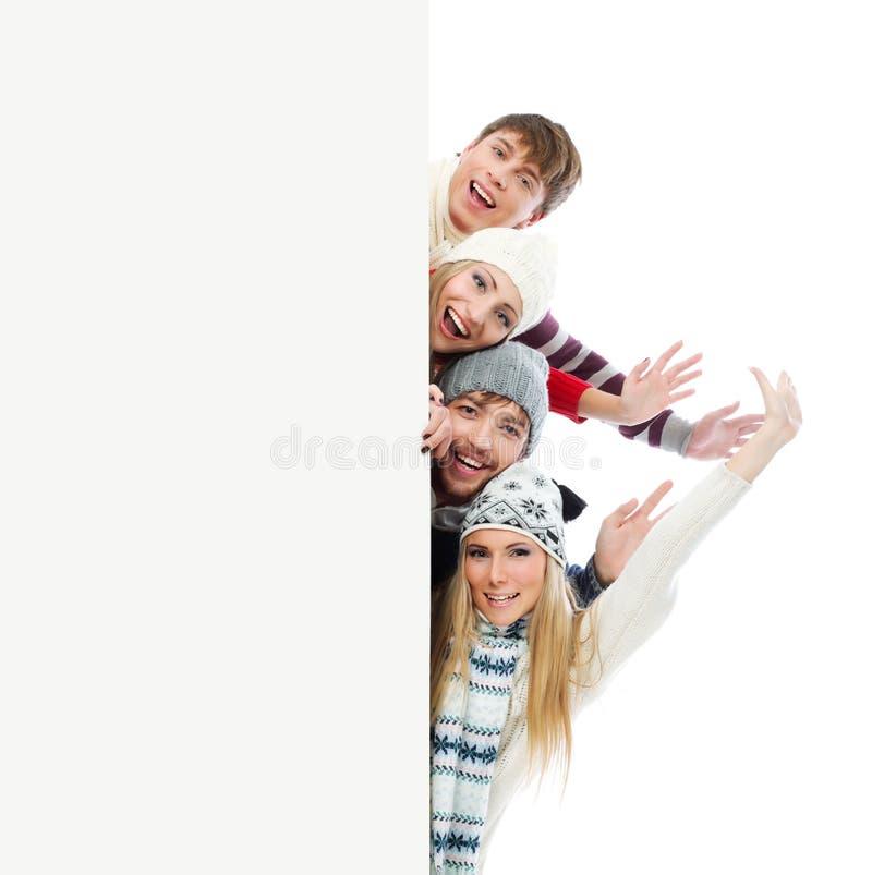 Les gens avec un panneau images stock