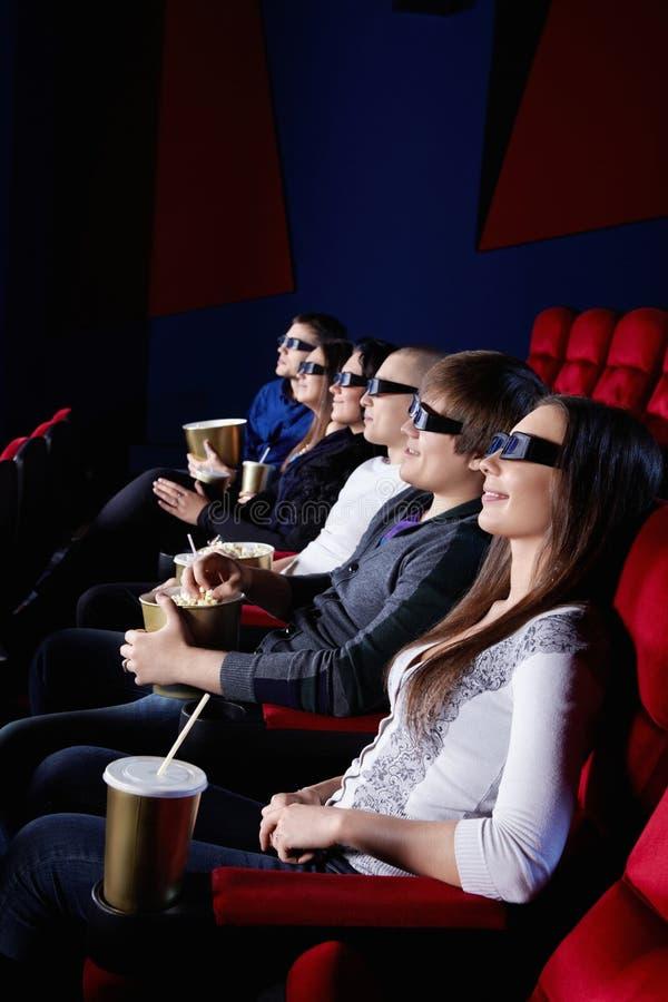 Les gens dans le cinéma photo stock