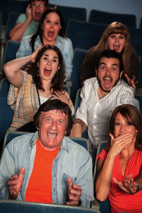 Les gens dans le théâtre photo libre de droits