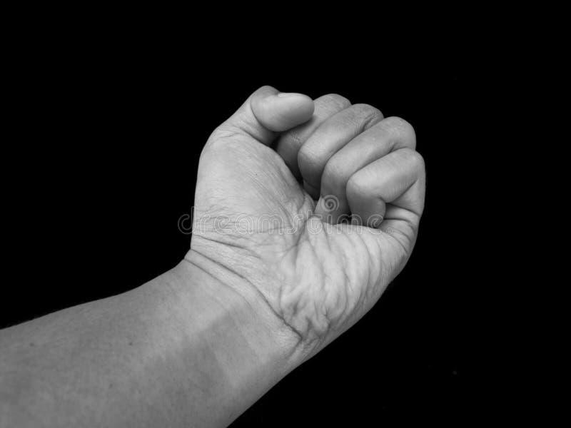 Les gestes remettent le poinçon, agression photo stock