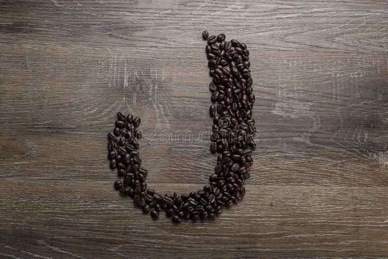 Les grains de café ont arrangé comme lettre J photos libres de droits