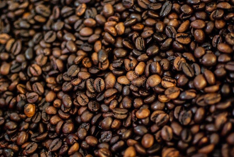 Les grains de café textued l'abrégé sur fond images stock