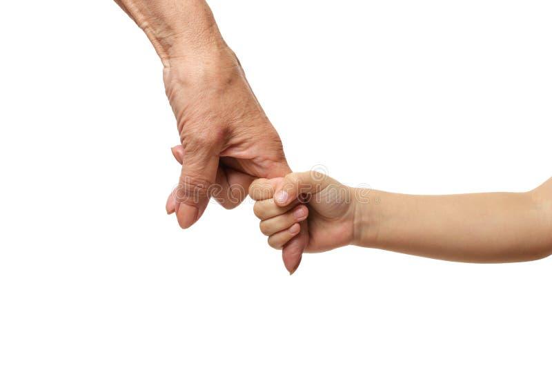 Les grands-mères remettent avec la main de petite fille d'isolement sur le fond blanc photos stock