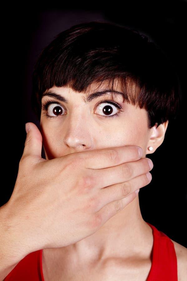 Les grands yeux avec remettent la bouche photographie stock libre de droits