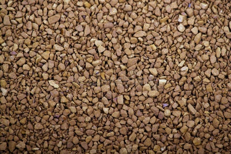 Les granules de cafè moulu pâlissent le brun photographie stock libre de droits