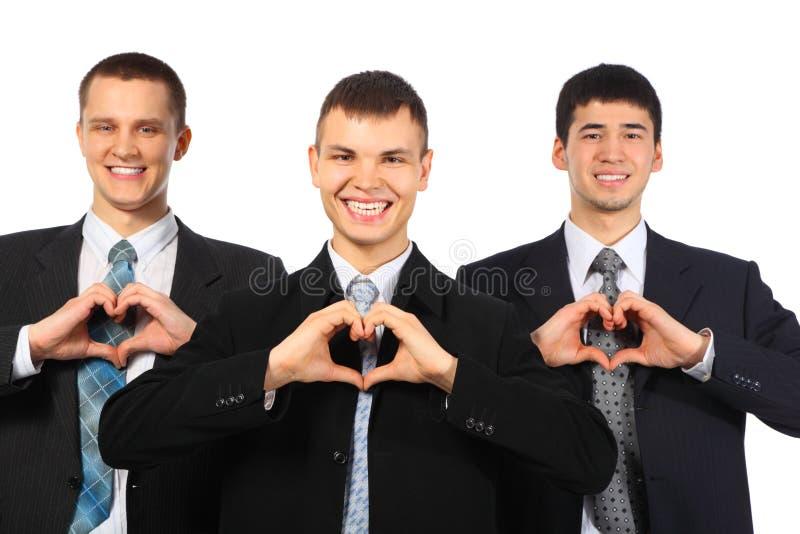 les hommes d'affaires aiment le signe trois de sourire d'exposition photo stock