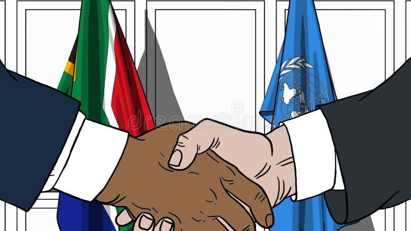 Les hommes d'affaires ou les politiciens se serrent la main contre des drapeaux de l'Afrique du Sud et des Nations Unies Réunion  illustration libre de droits
