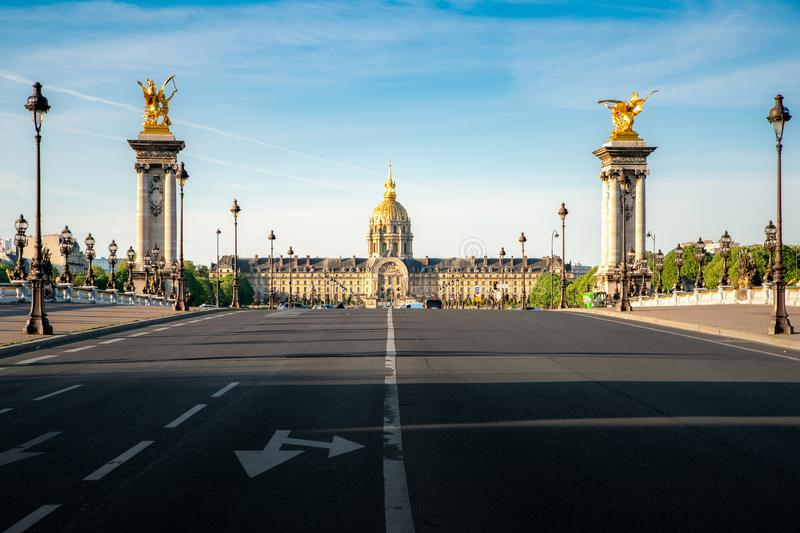 Les Invalides National Residence of the Invalids - complex of museums and monuments and Pont Alexandre III bridge in Paris, royalty free stock photography