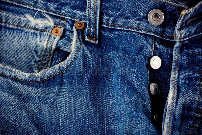 Les jeans défectueux de bouton de denimand et d'argent de fond de jeans avec une couture de mode de vintage conçoivent la texture photo stock