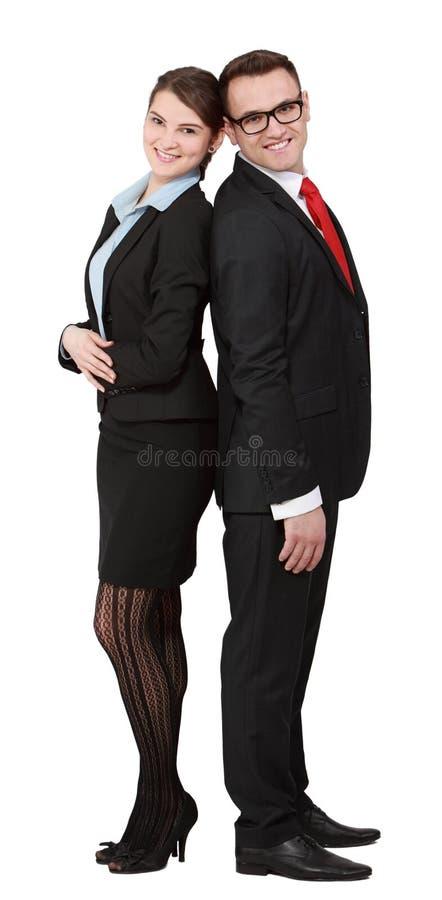 Les jeunes couples d'affaires soutiennent dessus de retour image libre de droits