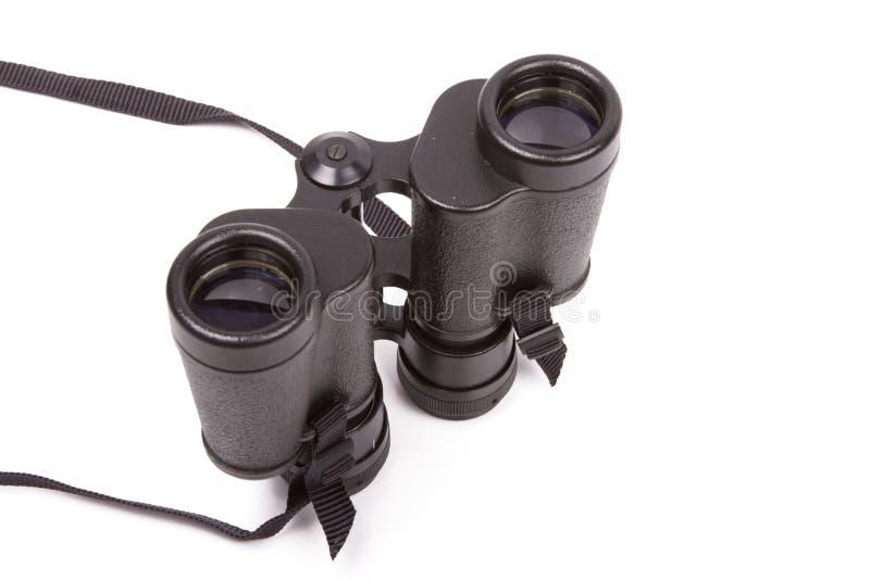 les jumelles noircissent le blanc d'isolement images stock