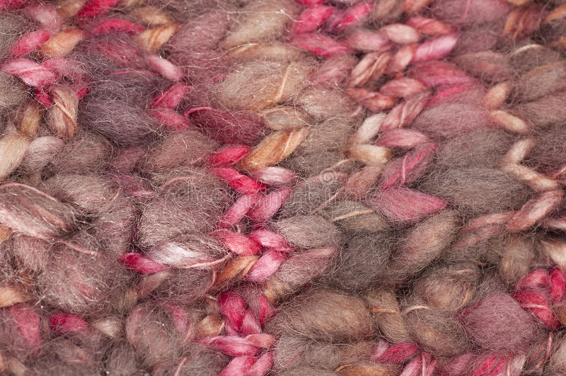 Les laines tissées donnent une consistance rugueuse dans les roses photographie stock