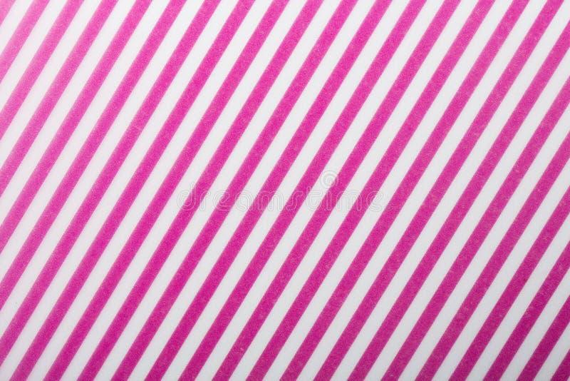 Les lignes diagonales de rose et blanches papier de modèle pour papier peint de textile motif de remplissage l'écharpe extérieure photo libre de droits