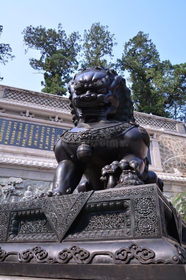 Les lions en pierre de la Chine antique photographie stock libre de droits