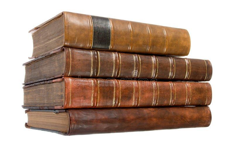 les livres bondissent la vieille pile en cuir images libres de droits