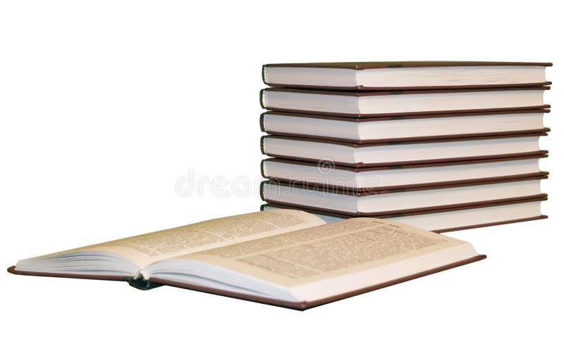 Les livres empilent avec un ouvert photos libres de droits