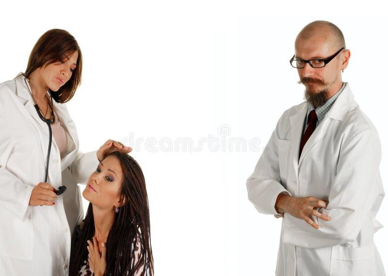 les médecins ont remarqué des jeunes photographie stock